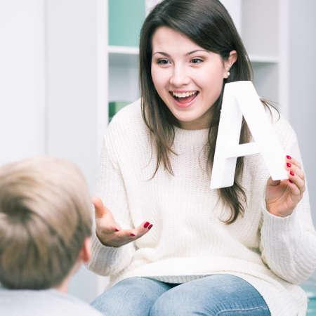 Shot of a speech therapist and a little boy Stock Photo