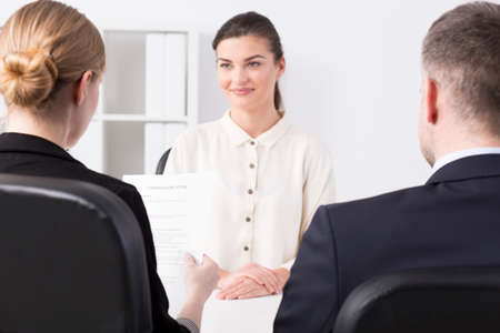 recruiters: Shot of a young job applicant talking to recruiters