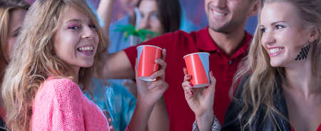 celeb: Couple of friends making a toast during the students party