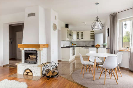 Open floor flat with fireplace, dining area and light open kitchen
