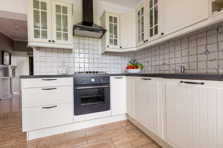 tiling: Small functional kitchen interior with stylish furniture and modern tiling