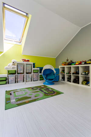 Shot of a spacious kids room with shelves full of toys