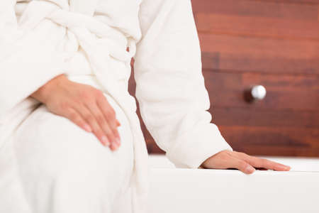 cropped: Cropped picture of a woman wearing a white bathrobe