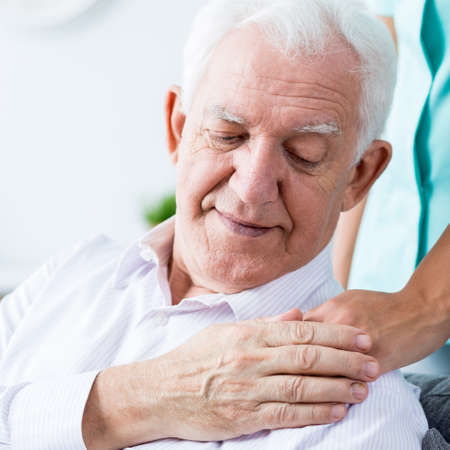 helpful: Close-up of nurse giving somebody helpful hand Stock Photo