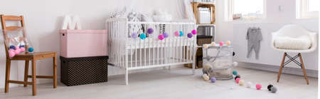 scandinavian people: Light and spacious baby girl room with simple cot, chairs and decorative elements, panorama