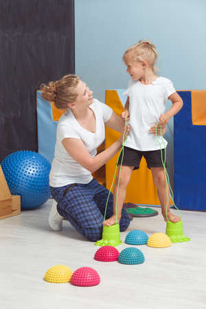 hemispherical: Shot of a young physiotherapist assisting her little patient during a sensory integration therapy