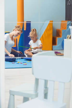 sensory: Shot of a young therapist and her patient during a sensory integration therapy