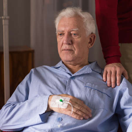 incurable: Senior man with incurable disease being on an IV