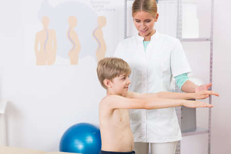 deformity: Shot of a young doctor examining a little boy in her office Stock Photo