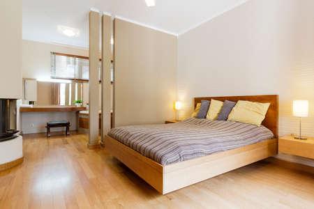 master bedroom: Shot of a king-size bed in a modern light bedroom