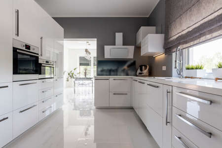 white kitchen: Shot of a modern grey kitchen with white furniture Stock Photo