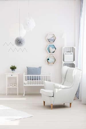 inspiring: White elegant armchair in inspiring marine baby room