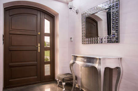 mirror image: Image of new design home hall with decorative mirror