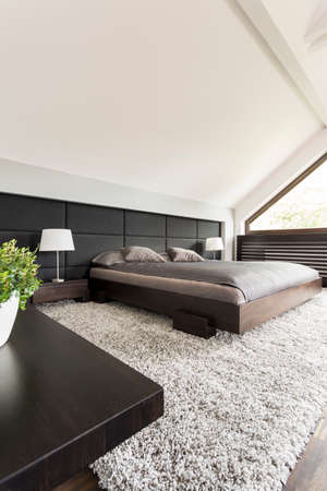 kingsize: Shot of a king-size bed in a spacious modern bedroom