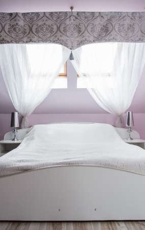 king size bed: Image of comfortable white king size bed in bedroom