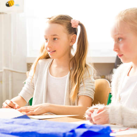 schoolroom: Shot of two little girls sitting in a classroom