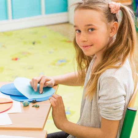 Shot of a young girl taking art class