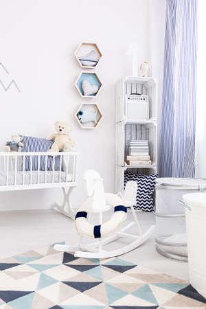 unisex: Cosy unisex baby space- childhood in marine style Stock Photo