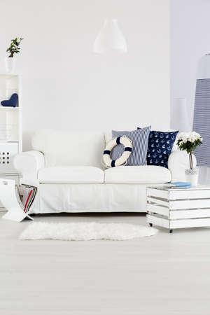 white interior: White cosy sofa in white marine style interior