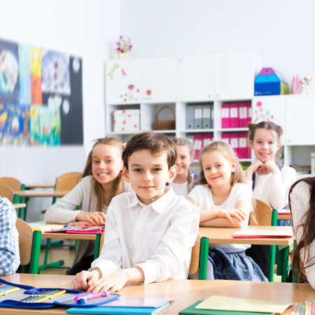 group shot: Shot of a group of children sitting in a classroom