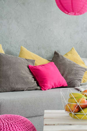 yellow fleece: Image of a grey flat with sofa and DIY coffee table Stock Photo
