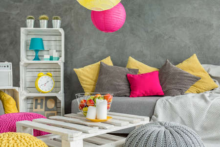 colorful chairs for living room. Living room with grey decorative wall finish  DIY furniture sofa and colorful details photo Cozy Room In Grey With Window Modern Furniture And