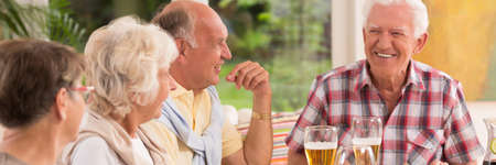 common people: Group of elder people talking during the common grill Stock Photo
