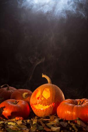 jack o latern: Scary tradition-jack-o-latern with smoke on black background