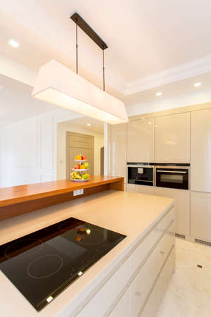 lacquered: White minimalist lacquered kitchen with modern household products