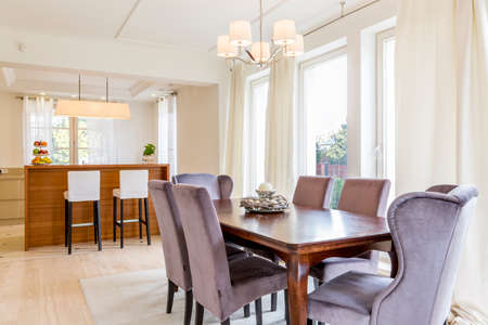 interior spaces: Elegant spacious dining room and open plan kitchen