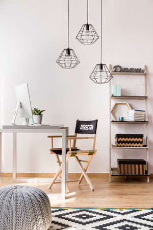 wools: Light home office in a new style with simple furniture, modern pendant lamp and pattern carpet