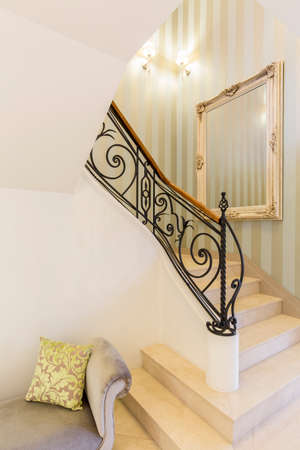elegant staircase: Elegant marble staircase and metal balustrade in stylish exclusive interior