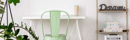 colores pastel: Home office area with minimalistic desk and chair in mint colour Foto de archivo