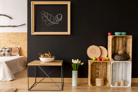 Modern room with DIY wooden furniture and blackboard wall