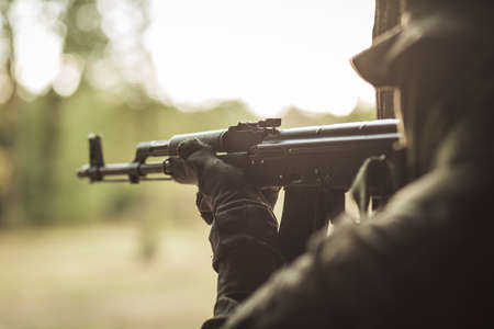 sniper training: Soldier on a training ground pointing his gun Stock Photo