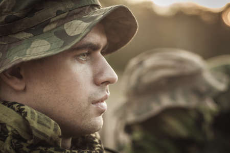 Close up of a young soldier wearing a military uniform