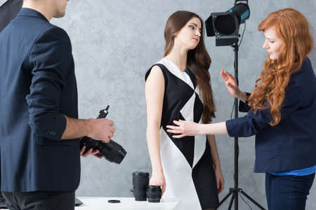 photo shoot: Shot of a stylist preparing a model for a photo shoot Stock Photo