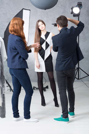 photo shoot: Shot of a model and two young photographers during a photo shoot
