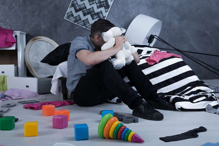robbed: Chaos in a house after burglary and despair father of a kidnapped child Stock Photo