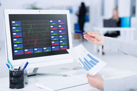 stock agency: Business analyst presenting some data on a white computer screen