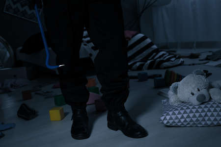 Kidnapper standing in a childs room at night