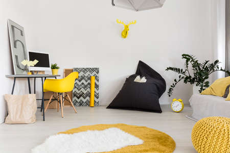New design light flat with desk, chair, carpet, sack chair, pouf and sofa Stock Photo