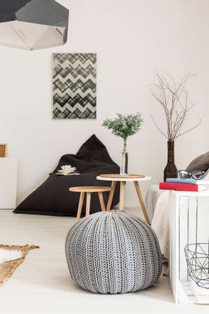contemporary living room: Modern living room in white with stylish pendant lamp, pouf, sack chair, side tables and DIY furniture