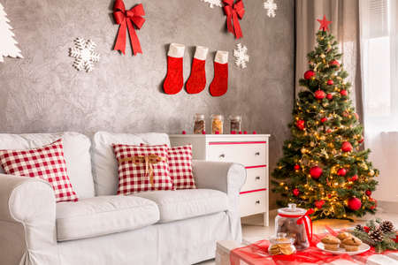 white pillow: Modern living room in grey and white with christmas tree and DIY wall decor
