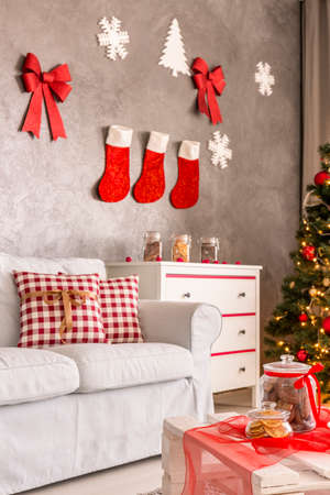 christmas decor: Modern apartment with DIY Christmas decorations hanging on the wall