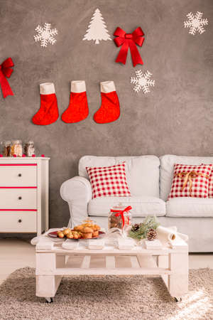 light living room with white furniture and diy christmas wall decoration stock photo 64785981