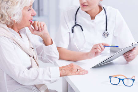 Woman doctor explaining the medical results to the senior woman Stock Photo