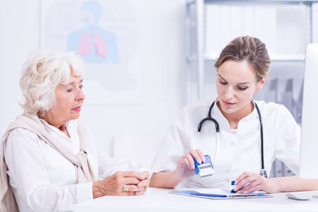 Elder woman sitting in consulting room with the young woman doctor