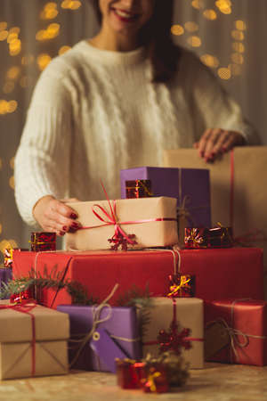 ranging: Woman is ranging christmas presents for the family Stock Photo