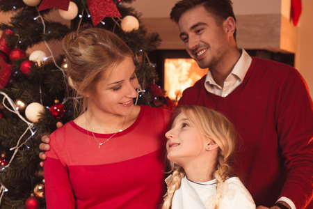 christmas spending: Happy smiling family spending Christmas at home Stock Photo
